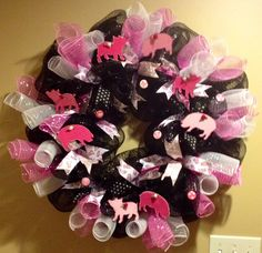 """Customer requested """"pigs..."""" this was what I came up with.  Black Deco Mesh and pink and white curls with hand painted pigs. Piggy ribbon and tiny rosettes."""
