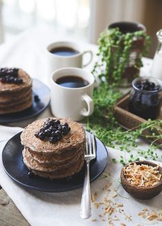 These cinnamon raisin oat bran pancakes have a combination of oat bran and buckwheat for a hearty texture with a touch of nutty toasted coconut. | Made with partner /bobsredmill/ oat bran.