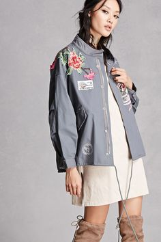 """An oversized lightweight woven jacket featuring floral and peacock embroidery, a studded star stitching, a """"Live Your Own Adventure"""" patch, high neckline, snap-button front, flap snap-button pockets, and long dolman sleeves. This is an independent brand and not a Forever 21 branded item. (This item runs large, please size down.)"""