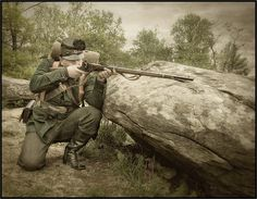 Civil War Sharpshooter at Little Roundtop. A Yankee Berdan sharpshooter. Notice green uniform and black rubber buttons to cut glare.