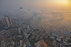 Qingdao, China - Heavy fog covers buildings in the city. Photograph: AFP/Getty Images