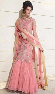 Appear as pretty as pretty can be in this salmon color embroidered net lehenga choli dress. This engaging dress is showing some superb embroidery done with resham and stones work. #LatestPinkIndoWesternStyleNetLehengaCholi