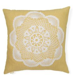 Lace Pillow Cover:     Stitched on sunny yellow linen, a vintage crocheted doily straddles the line between traditional and contemporary.     ($46; tuuni.etsy.com for similar)