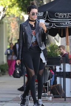 Kendall Jenner wearing Balenciaga Genuine Biker Jacket, Nike Free 4.0 Flyknit Sneakers in Black/Wolf Grey/Dark Grey/White, Givenchy Lucrezia Micro Bag, Alo Yoga Coast Leggings in Black, Slayer 1987 Reign in Pain T-Shirt and Ahlem Republique Aviators