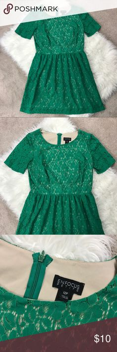 Green Lace Dress Here's a gorgeous green lace dress by enfocus studio in a size 12P! There is one stain on the inside as shown, it might come out in the wash, I haven't tried to do so yet! Luckily you can't see it when your wearing it! Other than that great condition and so cute! studio enfocus Dresses