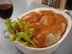 Kohlrouladen   (Stuffed cabbage rolls   with Tomato Sour Cream Gravy)