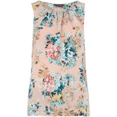 Blush vintage floral print top with ruffle split back detail. 100% Polyester. Machine washable.