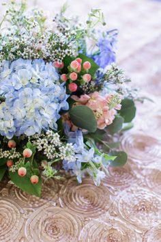 Blue and Peach and Ivory - Table centerpiece - wedding reception centerpiece - table decor - wedding tables - Table ideas - wedding inspiration - Southern Elegance - Southern Wedding - Knoxville TN florist - Wedding Florist Knoxville TN - Lisa Foster Floral Design - Blue Hydrangeas - Roses - Stock - Delphinium - Wax flower - www.lisafosterdesign.com....... my favorite colors for a bouquet that I have found so far! Gorgeous!!
