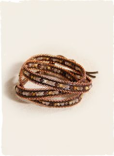 Peruvian Connection | Copper Beaded Wrap Bracelet The leather and copper chain wrap bracelet is threaded with jasper, agate and coppery crystals