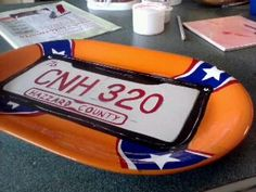 """another pinner wrote  'for my boyfriends birthday, he loves the old dukes of hazzard series so i made him his own dukes of hazzard general lee donut plate :) made from a white porcelain cookie plate and some 1shot pinstripe paint. Dishwasher proof!!"""""""