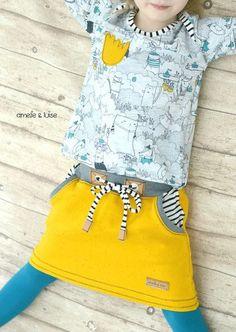 """""""Cozy-Skirt-Girls"""" ist ein Schnittmuster mit Anleitung für einen gemütlichen Jersey- oder Sweatrock in zwei Varianten. In der großen Kängurutasche oder den  seitlichen Eingrifftaschen finden alle..."""