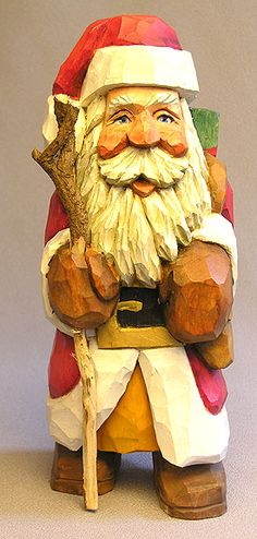Santa with presents and stick | Russell Scott, Scott Carvings, St. Paul, Minnesota | http://scottcarvings.com/