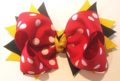 This Hair Bow is spikey and fun~ 2 Layers of Ribbon and Spikes and measures 5 inches~ This Bow is shown with Red and White Dot Ribbon Print,