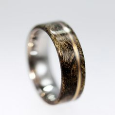 Buckeye Burl Wood rings on a Titanium ring with Bronze ring pinstripe - Matte Finish