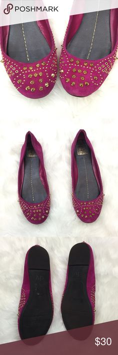 🍀DOLCE VITA Bright Maroon Spike Studded Flats Get these wild and rocker flats!  Stand out with the bright maroon color and the gold spikes!  These are made with a faux suede-like material and are embellished with different kinds of studs and spikes.  These have been worn a few times.  These show some minor wear.  Observe the heel on both flats and see there is a slit at the back.  I am not sure if this is intentional design or due to wear.  This is in good wearable condition!  Get this now…