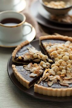 http://gourmandeinthekitchen.com/chocolate-coconut-macadamia-tart-recipe/
