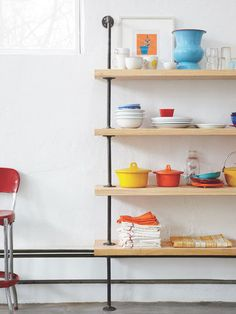 Flanges + Pipes + Pine Boards = Quick-Assembly Shelves: Built-in shelving comes in many flavors: traditional, modern, DIY, modular... Here is a great tutorial that shows us how to take hardware store items and turn them into an industrial and minimalist shelving unit.