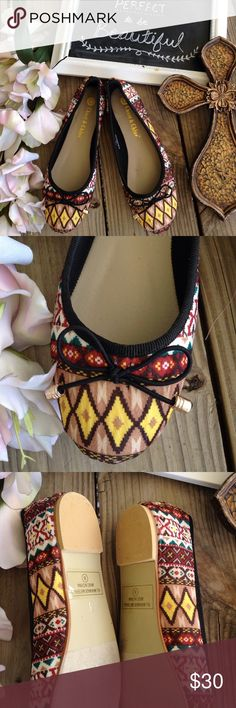 Chase & Chloe Tribal Bow Flats Size 8. Yellow, H, tan, brown, maroon, and turquoise soft fabric flats. By chase and Chloe very good condition. Sold at Nordstrom's Shoes Flats & Loafers