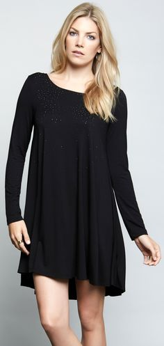 Comfort and style are synonymous on a jersey-knit swing dress with a smattering of sparkles on the front.