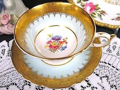 Paragon tea cup and saucer blue & thick gold band etched floral teacup pattern