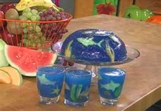 Jell-O Aquarium Rachael Ray Show While the Jell-O is chilling use fish-shaped cookie cutters to cut the sliced fruit into the shapes Video available on recipe site I want some Ocean Party, Shark Party, Luau Party, Pirate Party Games, Pirate Theme, Pirate Snacks, Pirate Food, Blue Jello, Jello Cups