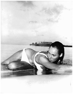 Ursula Andress emerging from the waves in this white bikini in James Bond: Dr. No has to be one of the most memorable Bond Girl – and swimwear moments of all time. Ursula Andress, Jeanne Moreau, Bond Girls, Bardot, Divas, Honey Ryder, Photo Star, Marcello Mastroianni, James Bond Movies