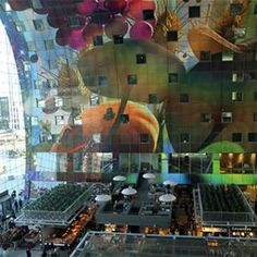 If Amsterdam is a study in old-world elegance, then the scrappier port city of Rotterdam is all big, futuristic ambition—and its constantly unfolding city center has become one eye-popping explosion of style. The latest attraction, and reason enough to visit, is the MVRDV-designed Markthal, an igloo-like horseshoe that houses 96 stalls (Dutch cheeses to Moroccan spices, reflecting the polyglot city), 20 shops, nine restaurants, and 228 apartments. It also happens to feature Holland's largest…