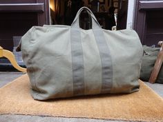 Vintage 1970s 70s 1979 US military flyers pilot kit bag duffle bag canvas Scovill zip up khaki green carry on by TheDustbowlVintage on Etsy https://www.etsy.com/listing/237023524/vintage-1970s-70s-1979-us-military