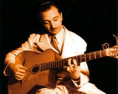 Before there was rock--The Selmer-Maccaferri Modele Jazz (first made in 1932), played here by Django Reinhardt who made it famous, was the first guitar with a cutaway and a steel reinforced neck.