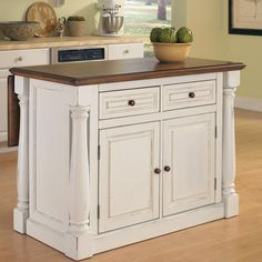 Features:  -Kitchen island.  -Stylish design.  -Two storage drawers and a storage cabinet.  -Hardwood solid and engineered wood construction.  -Antiqued white sanded and distressed oak finish.  -Finis