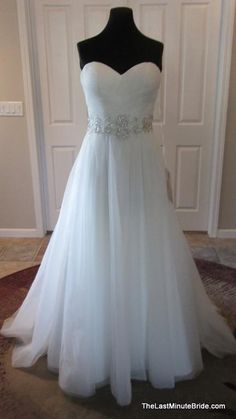 Essense of Australia style D1652. This satin and tulle wedding dress features a sweetheart neckline, figure flattering crisscross ruching on the bodice, and Diamante beading at the natural waist. The back of the dress is finished with crystal buttons over a zipper and a chapel length train