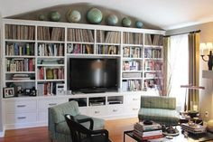 Collection of Globes and built-ins.  Music For Your Eyes: Beautifully Displayed Record Collections