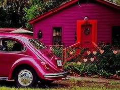 purply-pink car and house