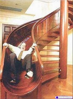 I would love to have these stairs in my house. I would walk up them just to have an excuse to go down the slide. :)