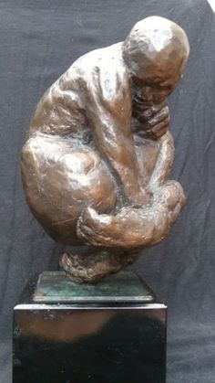 #Bronze #sculpture by #sculptor Marc Bodie titled: 'Nimbus (Bronze Little Crouching Thinking Man statue)'. #MarcBodie