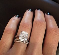 Yes I want a car on my hand. 3 carat Cushion cut in rose gold with delicate stackable wedding bands. #GOBIGORGOHOME