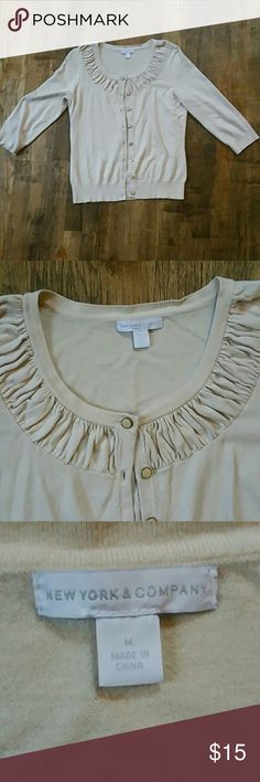 """New York & Company cream cardigan, 3/4 sleeve, M New York & Company cream cardigan, 3/4 sleeve, size medium, in good used condition. This cardigan has pretty buttons and detailing around the neck line. 77% rayon, 23% nylon.  Armpit to armpit - 17"""" Shoulder to hem - 21.5"""" New York & Company Sweaters Cardigans"""