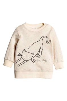 Sweatshirt: Top in sweatshirt fabric with press-studs on one shoulder and ribbing around the neckline, cuffs and hem.