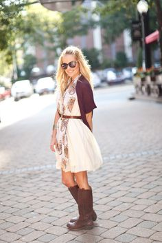 Sundress, printed scarf, belt, long sweater and boots.  love that she put the belt around everything