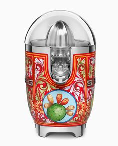 dolce & gabbana adorns smeg kitchen appliances with decorative sicilian motifs