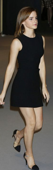Who made  Emma Watsons black dress and cap toe pumps that she wore in Cannes?