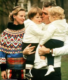 Margrethe and Henrik are pictured with their two children Prince Frederik and Joachim in 1...