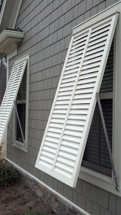 White bahama style exterior shutters by The Louver Shop