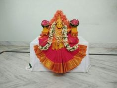 Varalakshmi decoration ideas at home Kalash Decoration, Decoration For Ganpati, Festival Decorations, Flower Decorations, Lakshmi Sarees, Ganesh Chaturthi Decoration, Ganapati Decoration, Pooja Mandir, Pooja Room Door Design