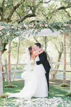 LOVE the arbor florals, I believe its lemon leaf? Stunning!   Read More: http://www.stylemepretty.com/california-weddings/2015/03/24/rustic-italian-olive-branch-winery-wedding/