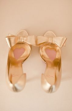 gold bow pumps.