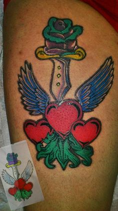 Old school hearts and dagger tattoo