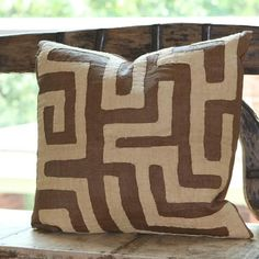 These large brown geometric Kuba-cloth pillows are all from one long vintage Kuba cloth appliquéd with natural wheat colored raffia. They are backed in coordinating brown linen with french seams. Small needle holes are sometimes visible from an original hand-sewn seam. Close inspection often reveals hand-sewn seams and other subtle marks from its past life. #globaltextile