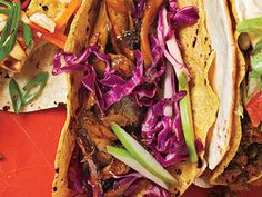 Beer-Braised Chicken Tacos with Cabbage Slaw | Cabbage and apple slaw adds a nice crunch. When you pair the slaw with beer-braised chicken, the tacos take on a German flair.