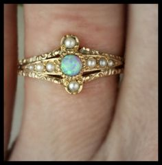 Detail of antique Victorian opal and seed pearl in chased rose gold.